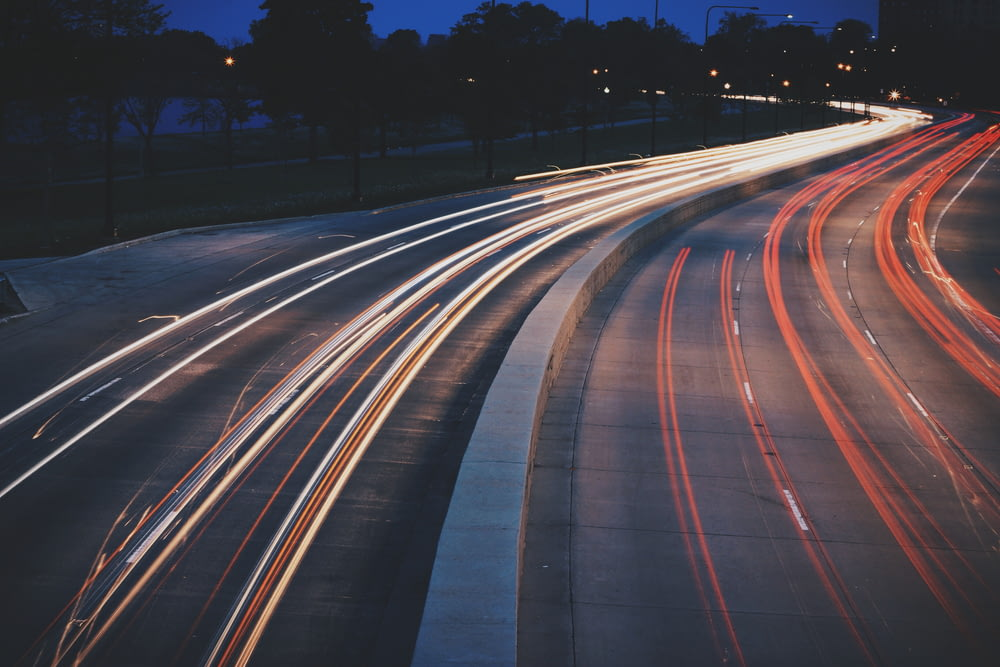 time-lapse of vehicles on road during night