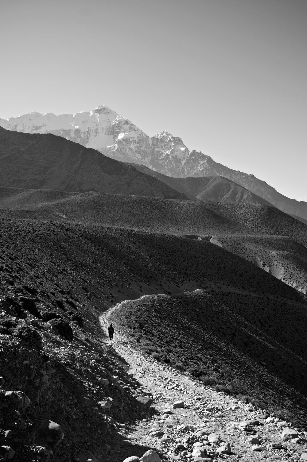 grayscale photograph of mountain during daytime