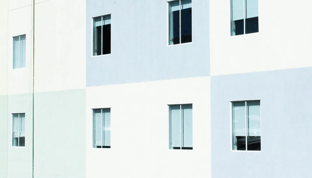 white and gray concrete wall with windows