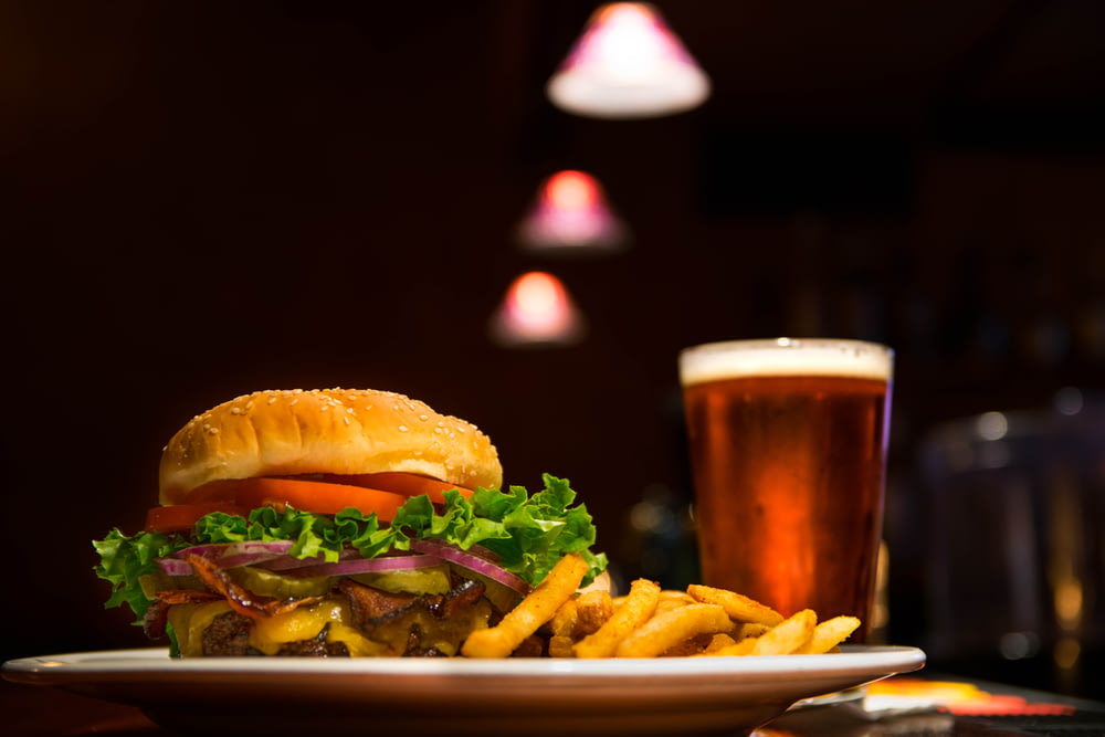 burger and fries on plate