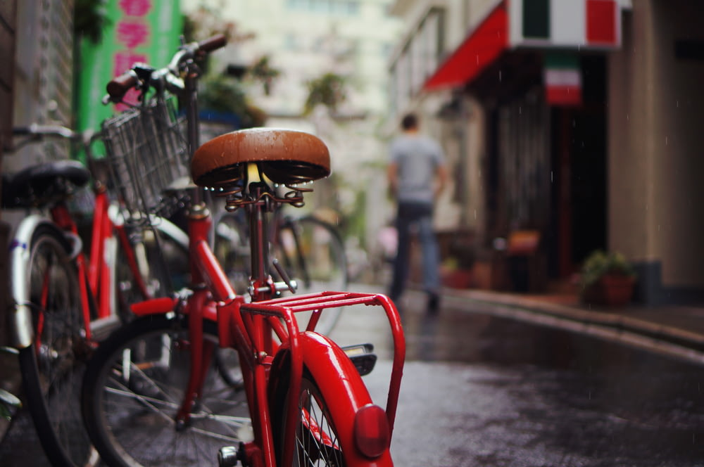 selective focus photography of red bicycle