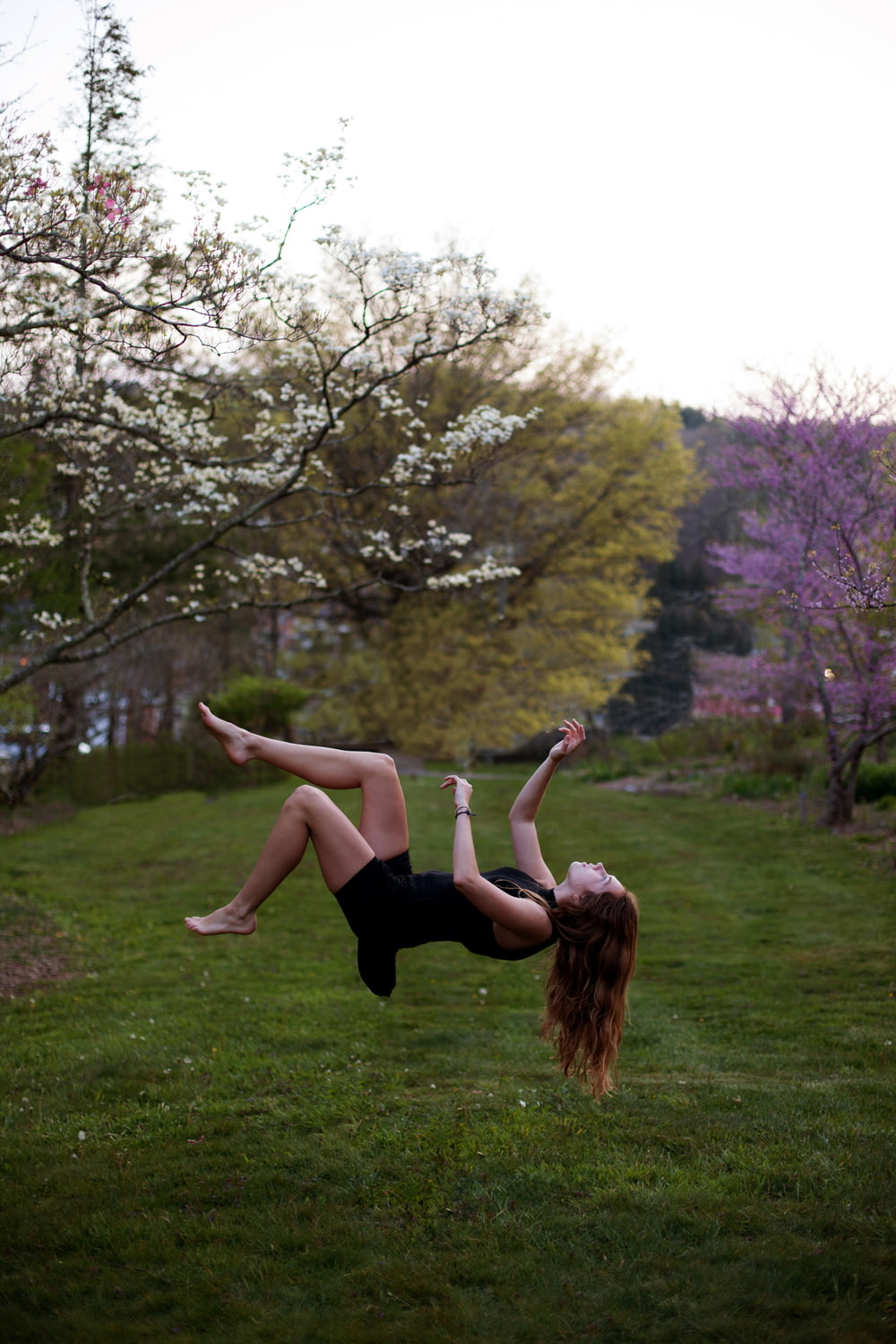 woman back flipping in the garden