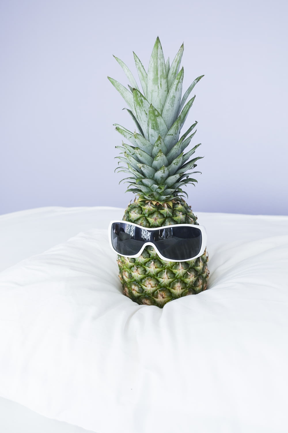 green pineapple with white shield sunglasses