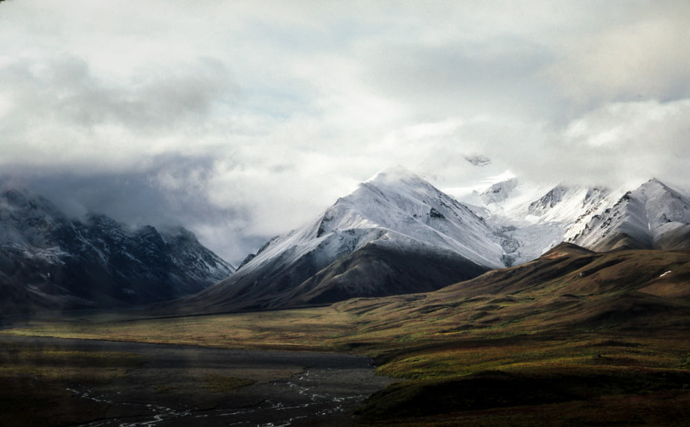 snow-capped mountain under sky