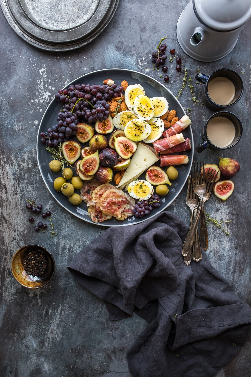 top view photography of fruits in plate