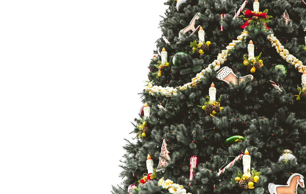Christmas tree covered with ornaments and tinsels