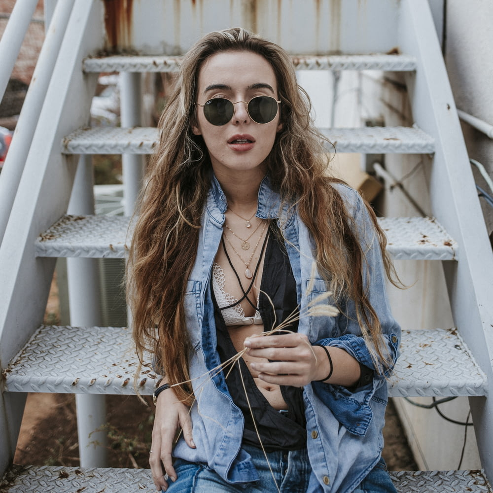 woman wearing black sunglasses on stairs