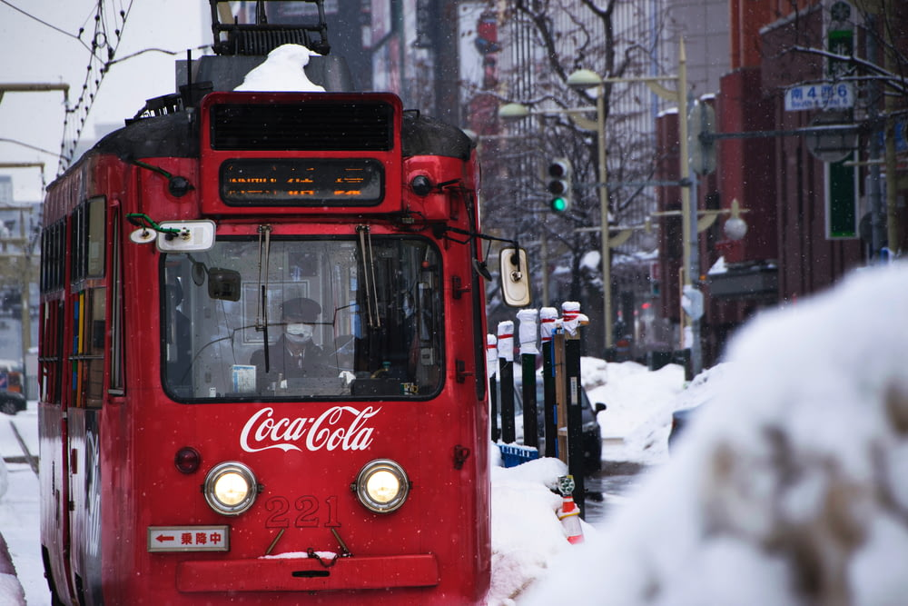 red Coca-Cola tram during snow