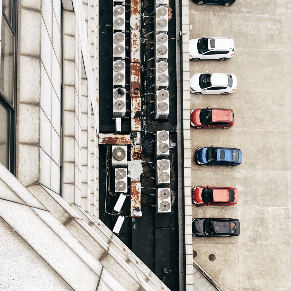 aerial photo of air condenser units and cars