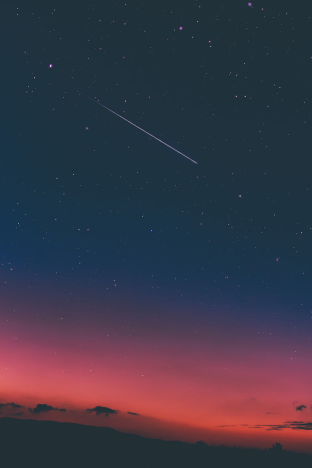 shooting star in night sky