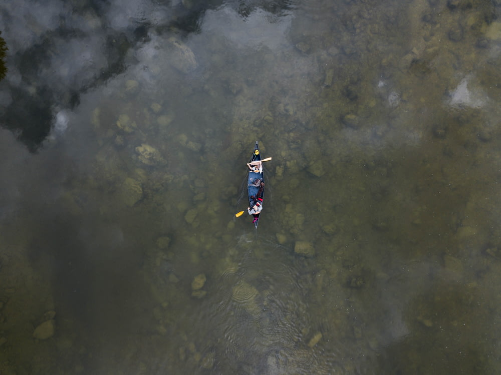aerial view photo of two person in row boat