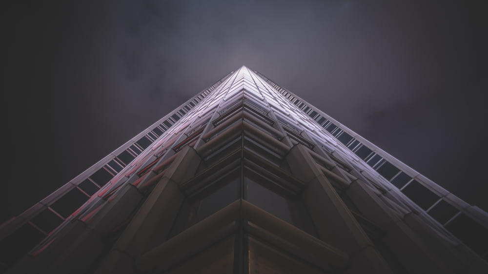 low-angle photography of white high-rise state of the art building