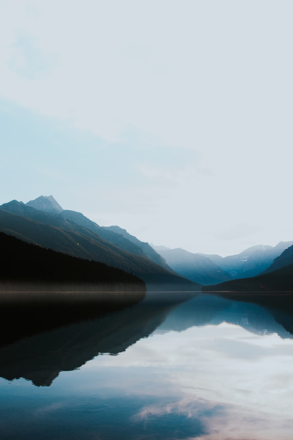 mountains surrounded by body of water