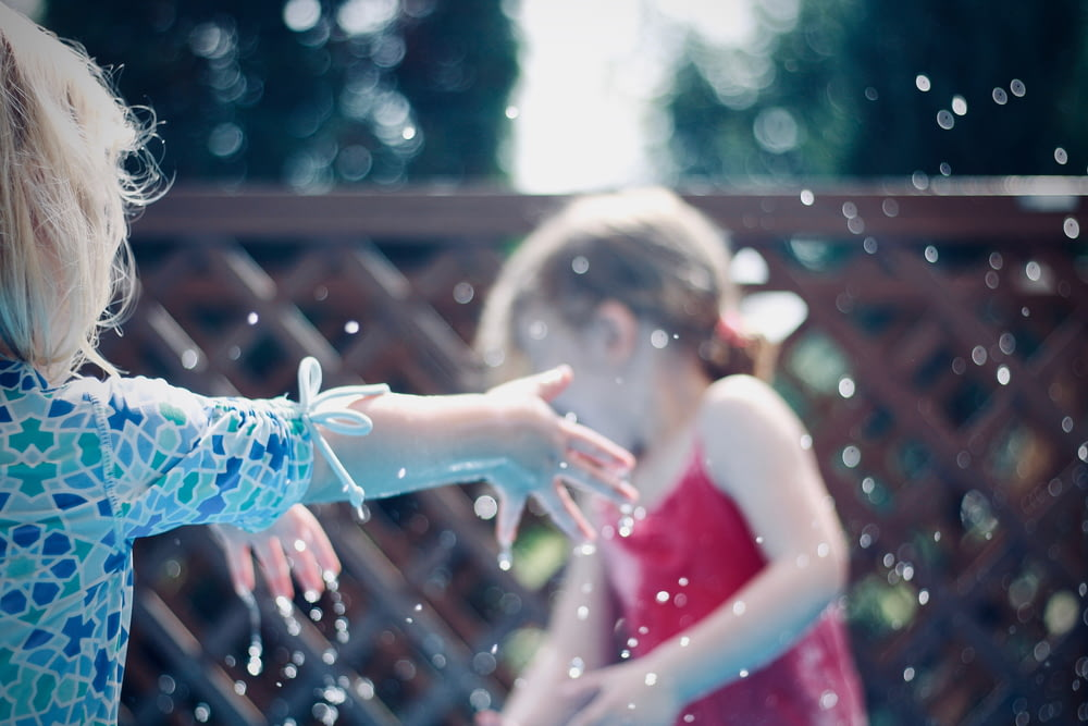 two children playing with water