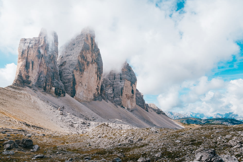 gray and brown rock formation under white clouds