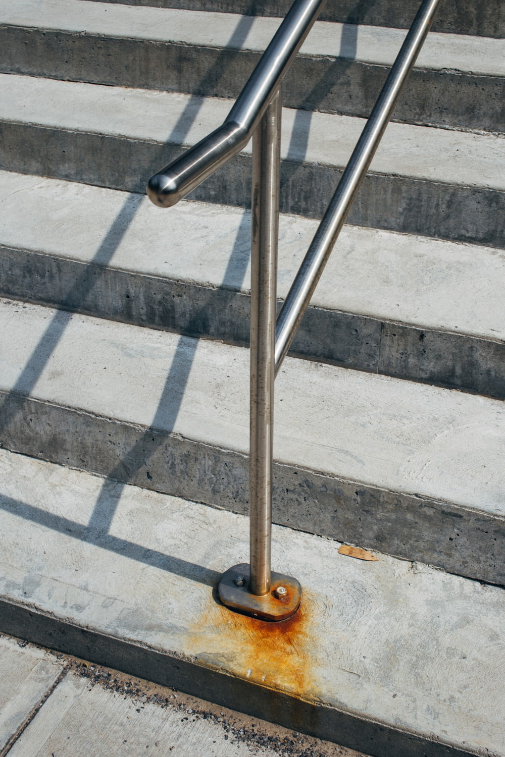 rust at the base of handrails on stairs