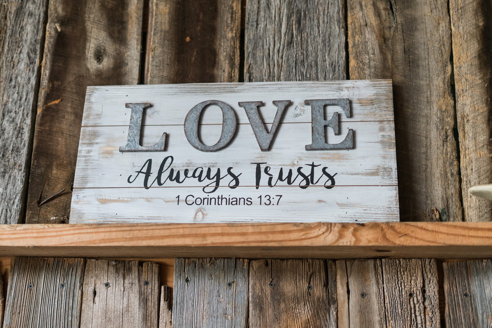 white and gray wooden quote board