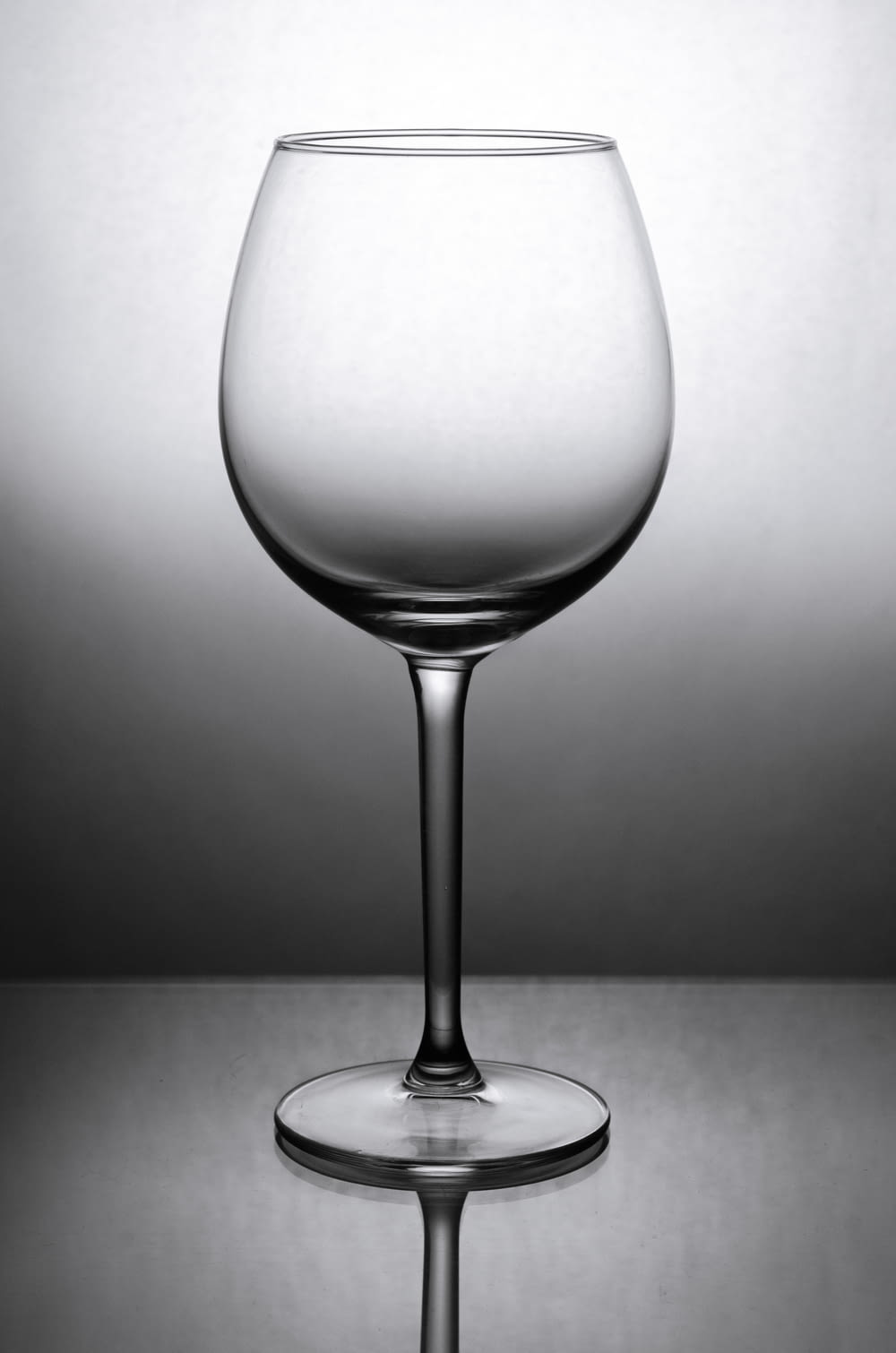 grayscale photo of wine glass