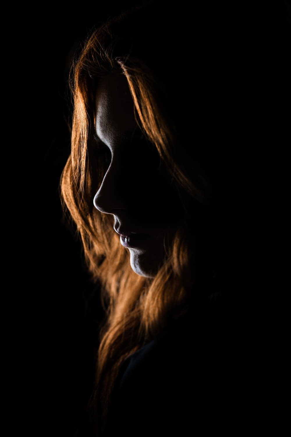 woman's face on black background