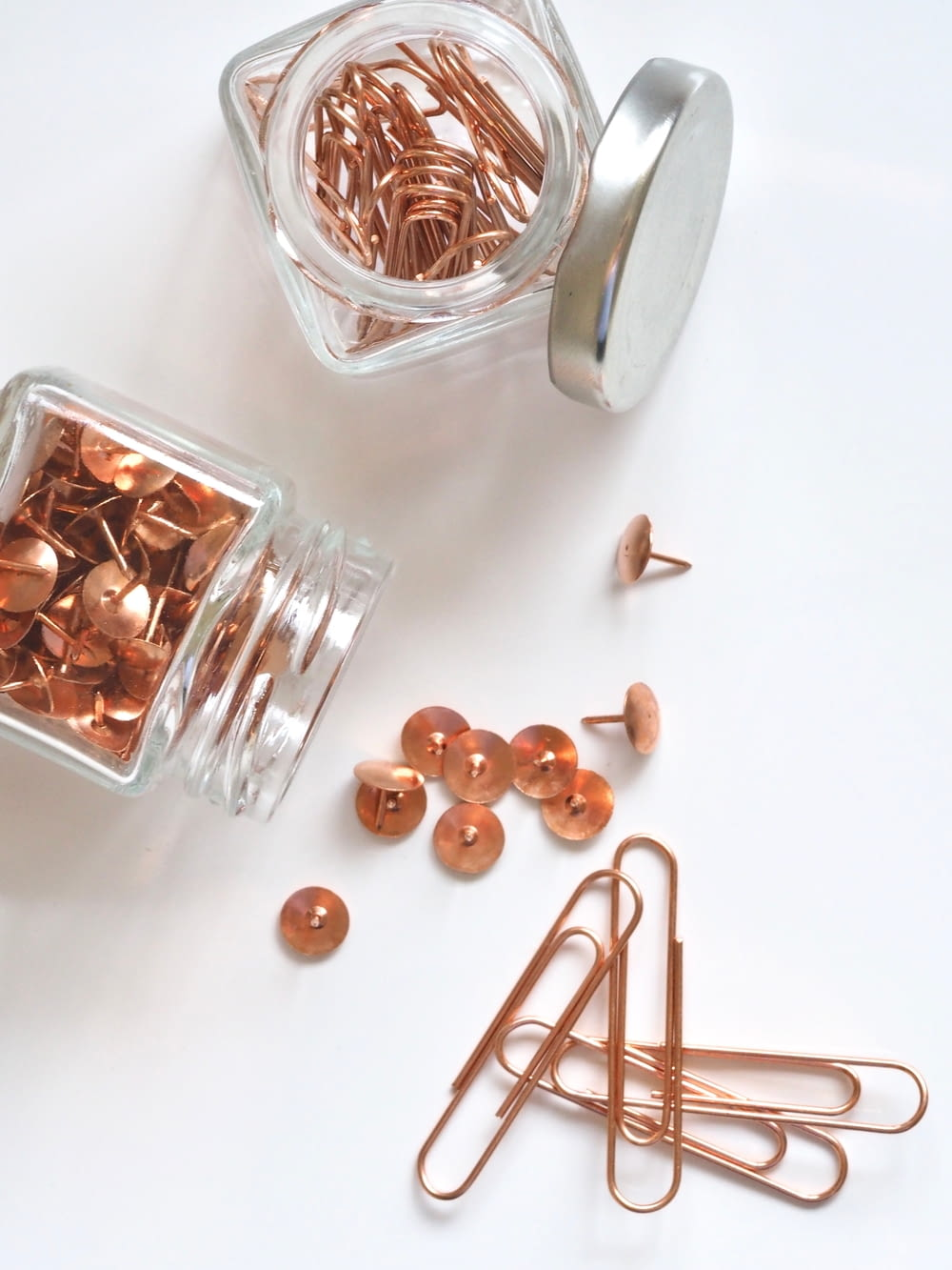 brass thumbtacks and paper clips