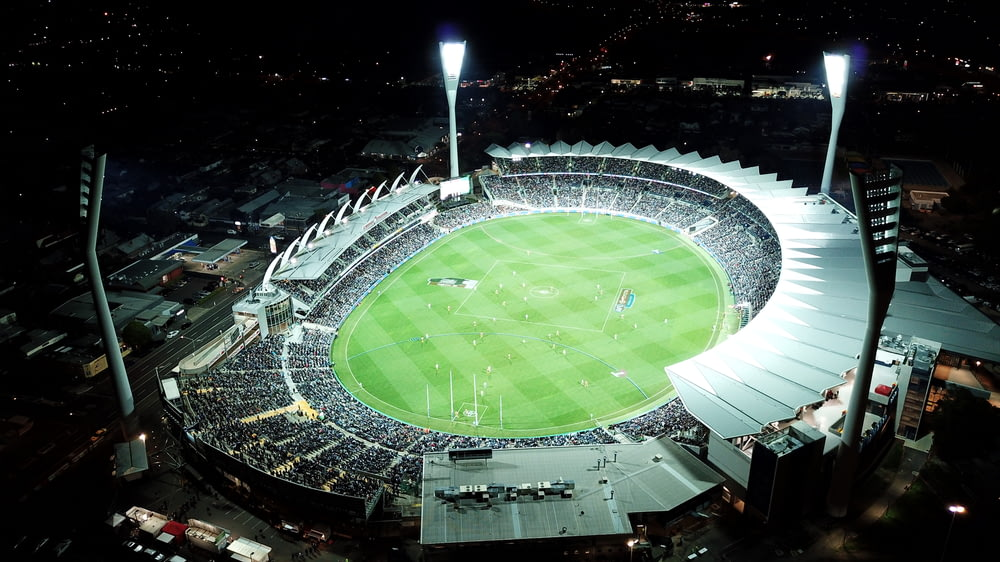 high-angle photo of round stadium at nighttime