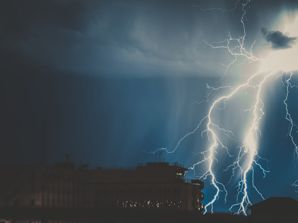 silhouette photo of thunder during nighttime