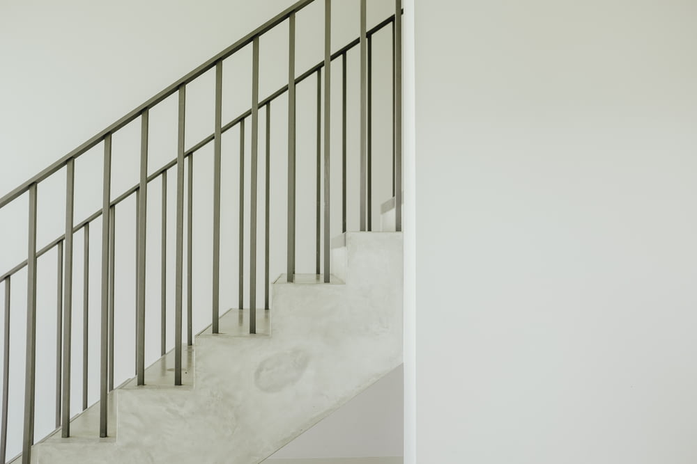 staircase with gray steel rail