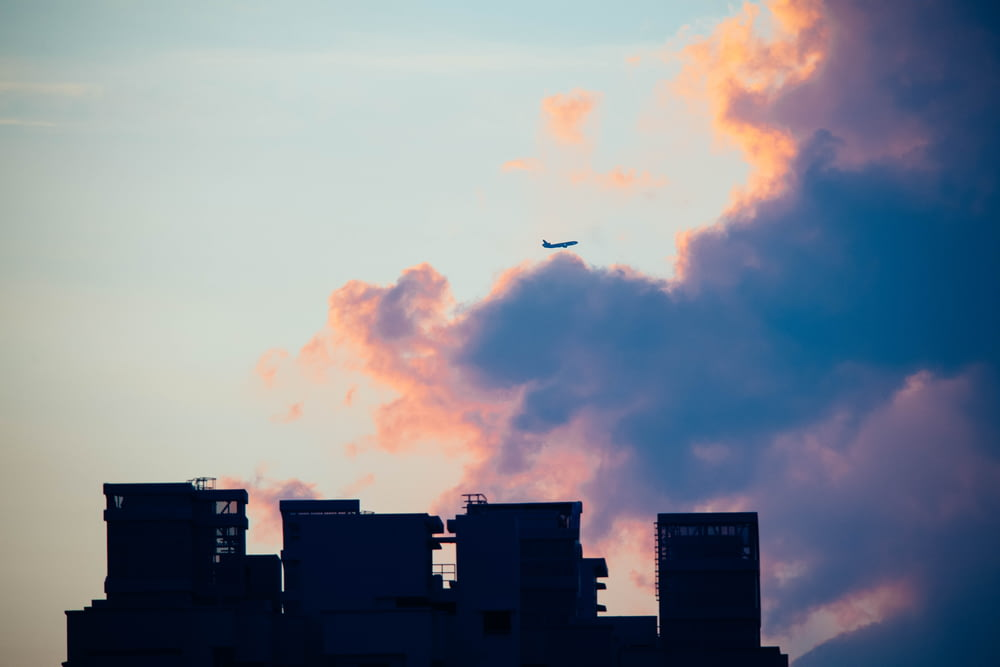 silhouette of buildings against clouds
