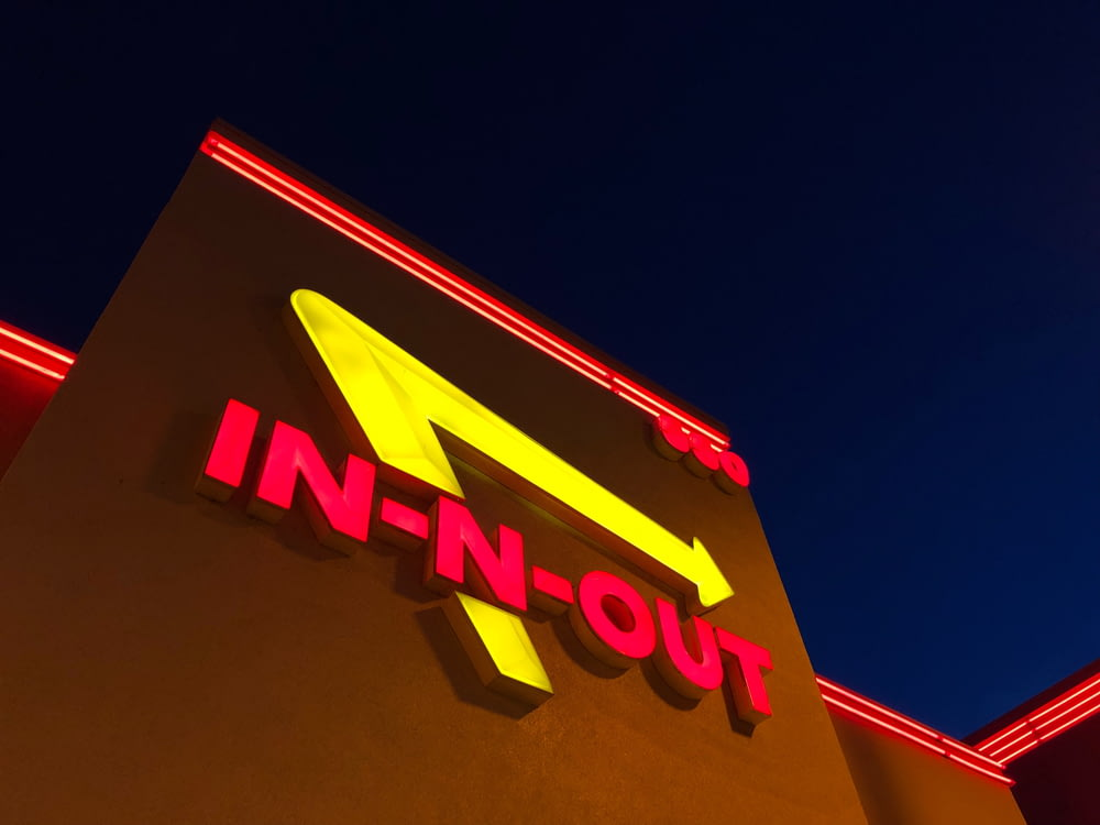 low angle photography of red and yellow In-N-Out signage