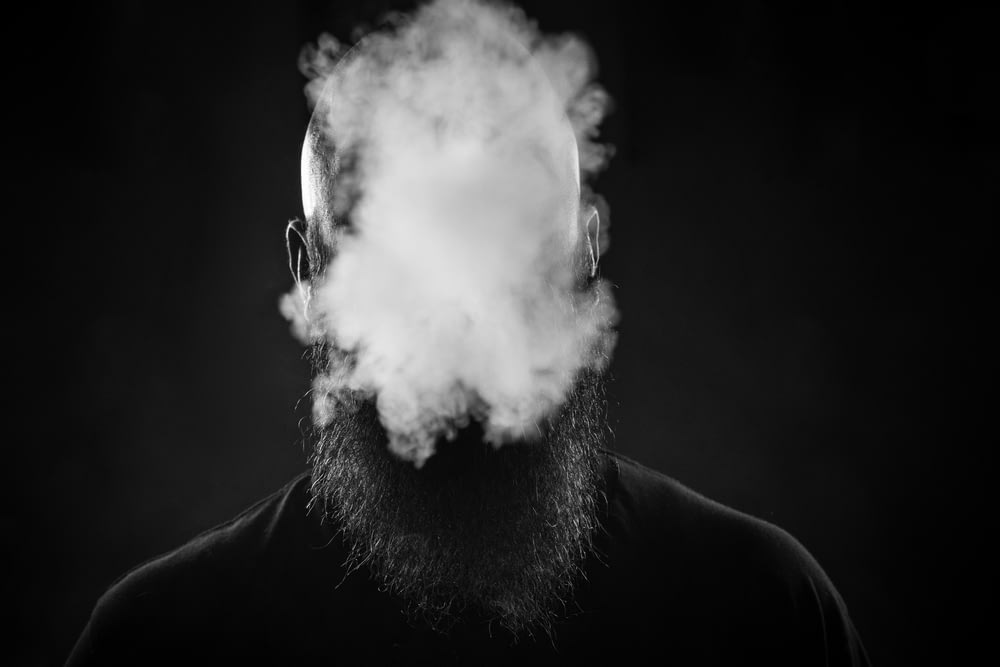 man making smoke