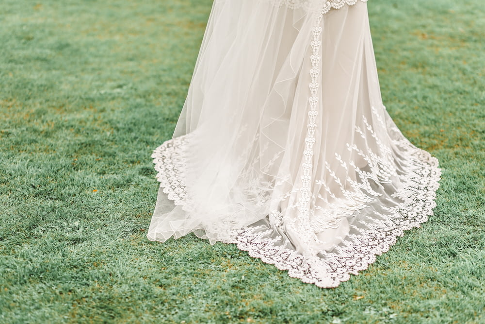 woman wearing white gown on grass