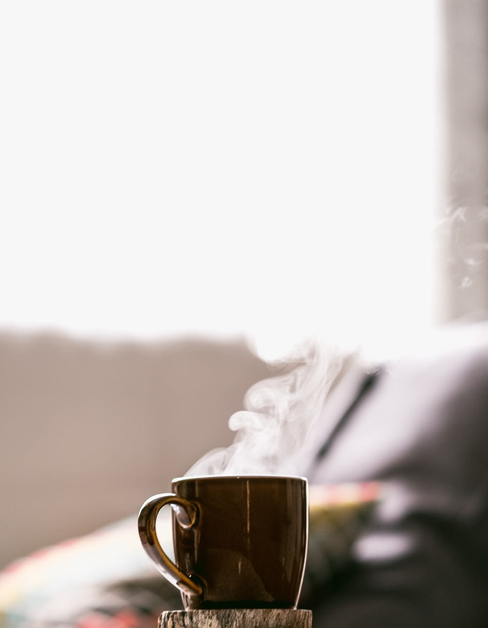 shallow focus photography of hot coffee in mug with saucer