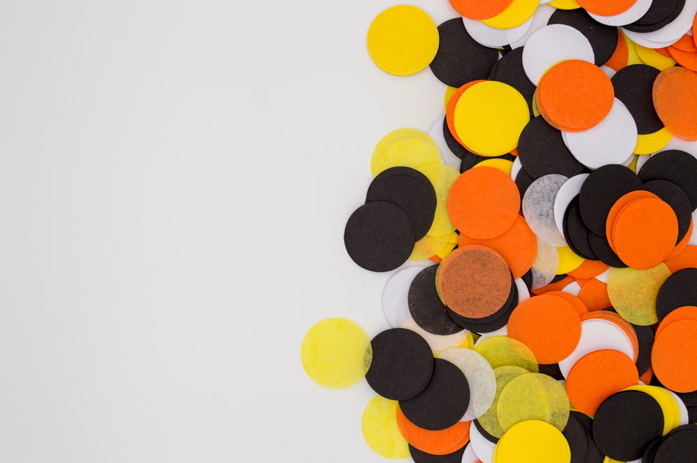 round assorted-color orange, white, and black paper decors