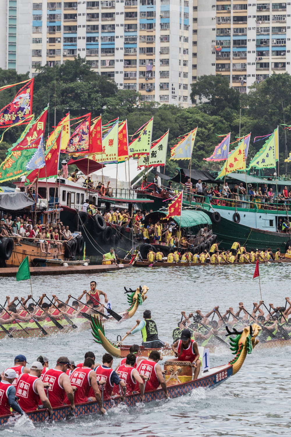 group of people riding dragon boat on water