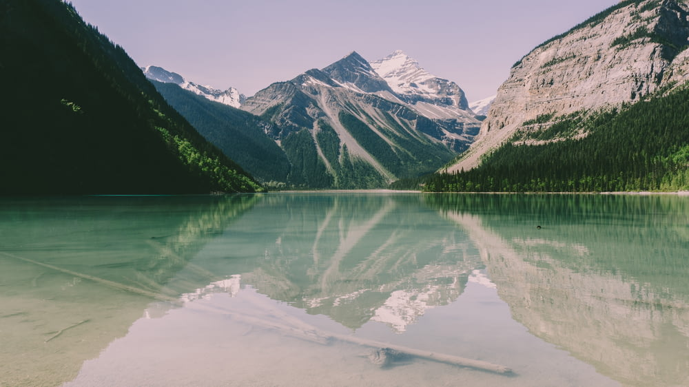 landscape photography of body of water near mountains