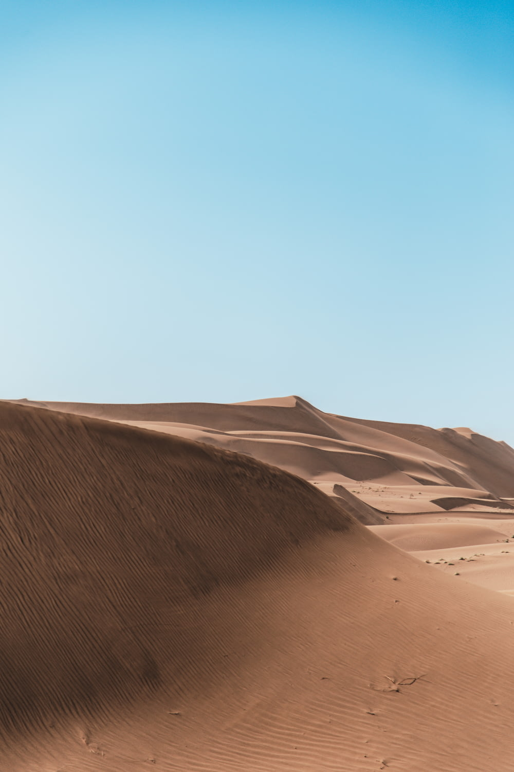 brown sand under white cloudy sky