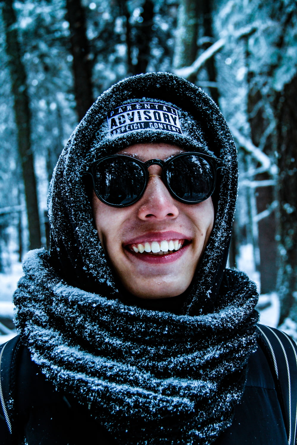 man wearing sunglasses and scarf