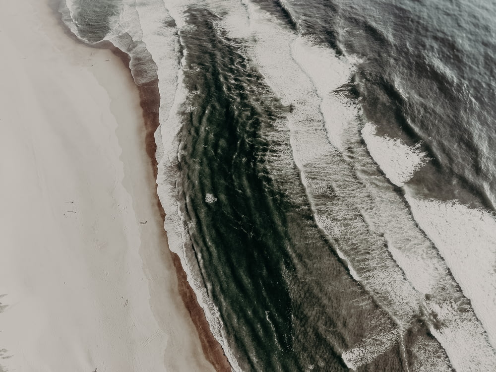 aerial photography of seawaves during daytime