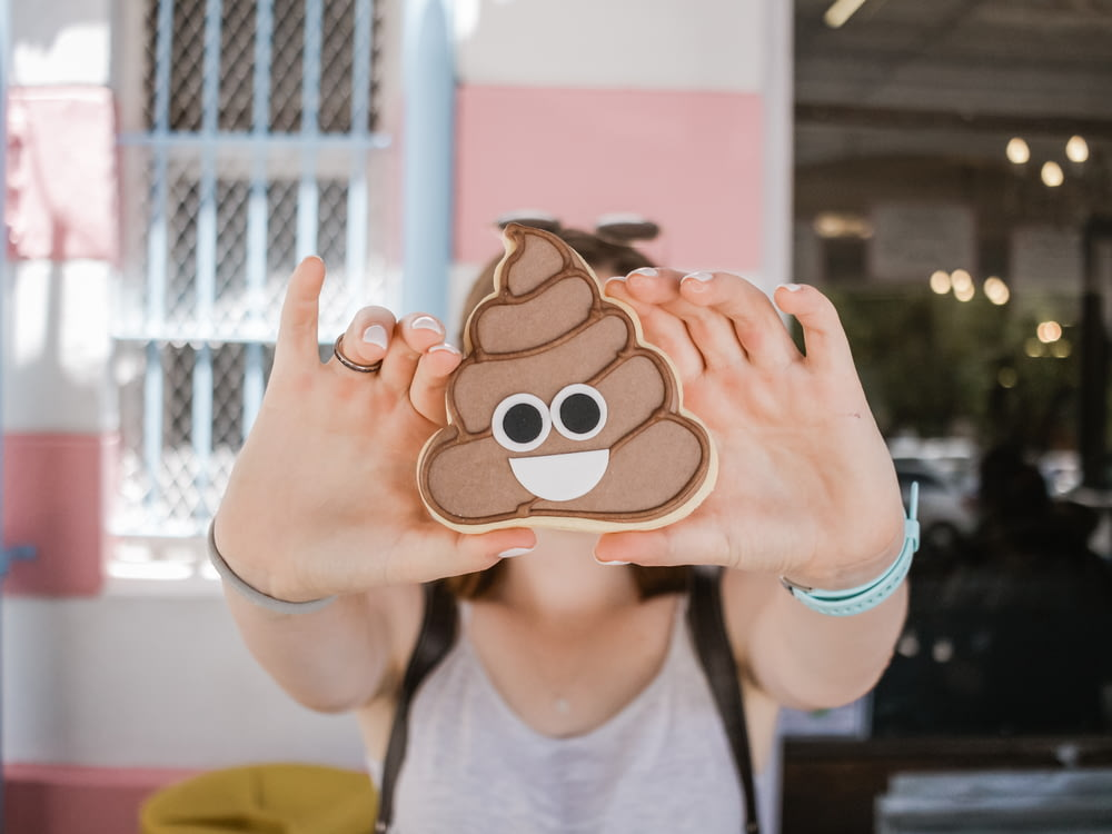 woman holding poop case