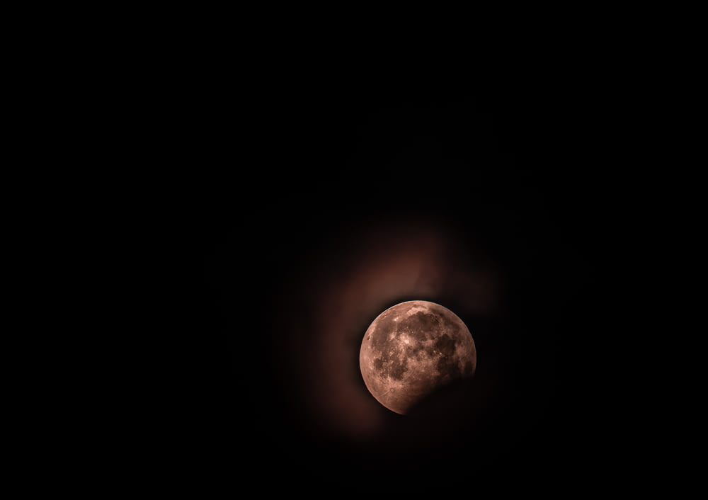 moon surrounded by black background