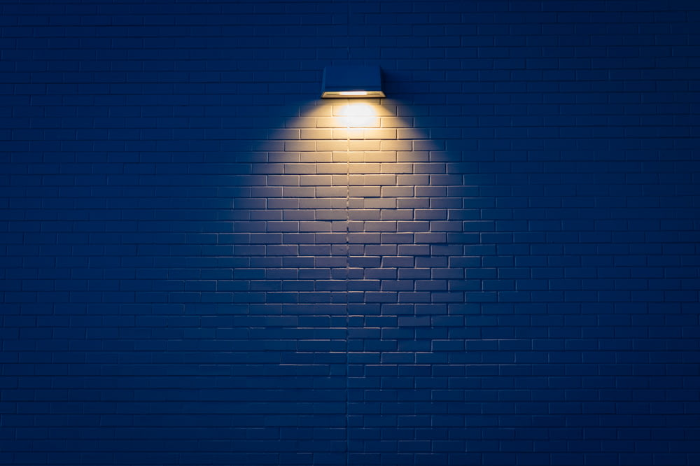wall lamp turned on on wall