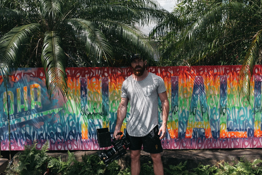 man standing near painted wall