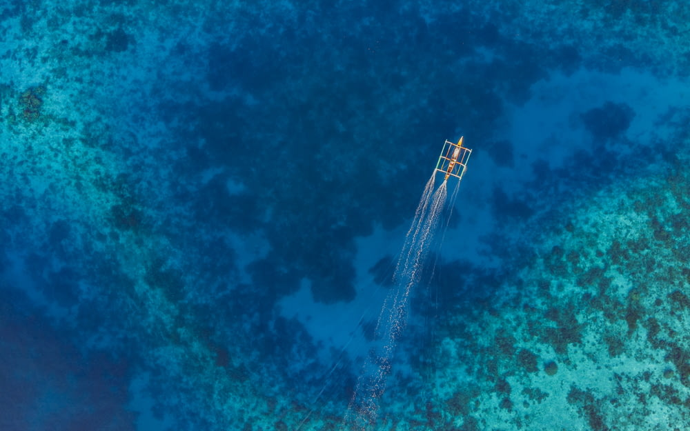 aerial-view photography of boat on sea