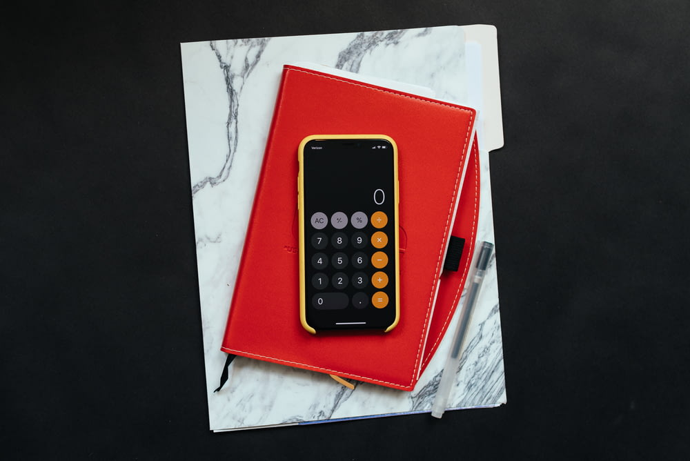 black Android smartphone on red flip case