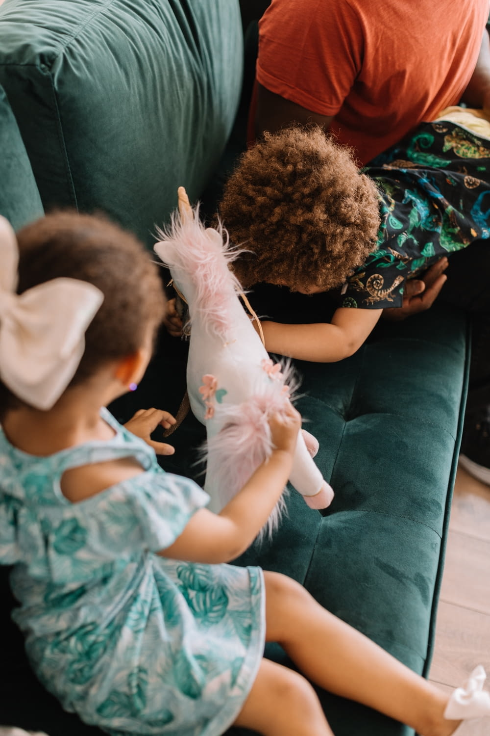 two children playing on sofa