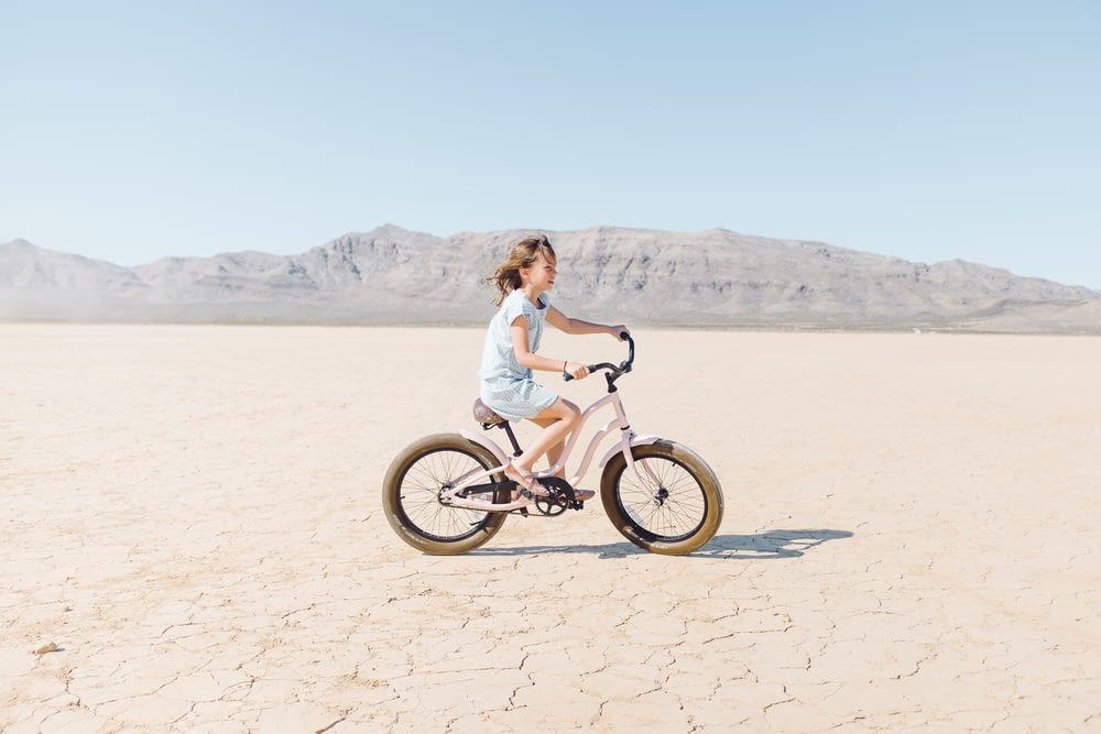 girl riding bicycle outdoor during daytime