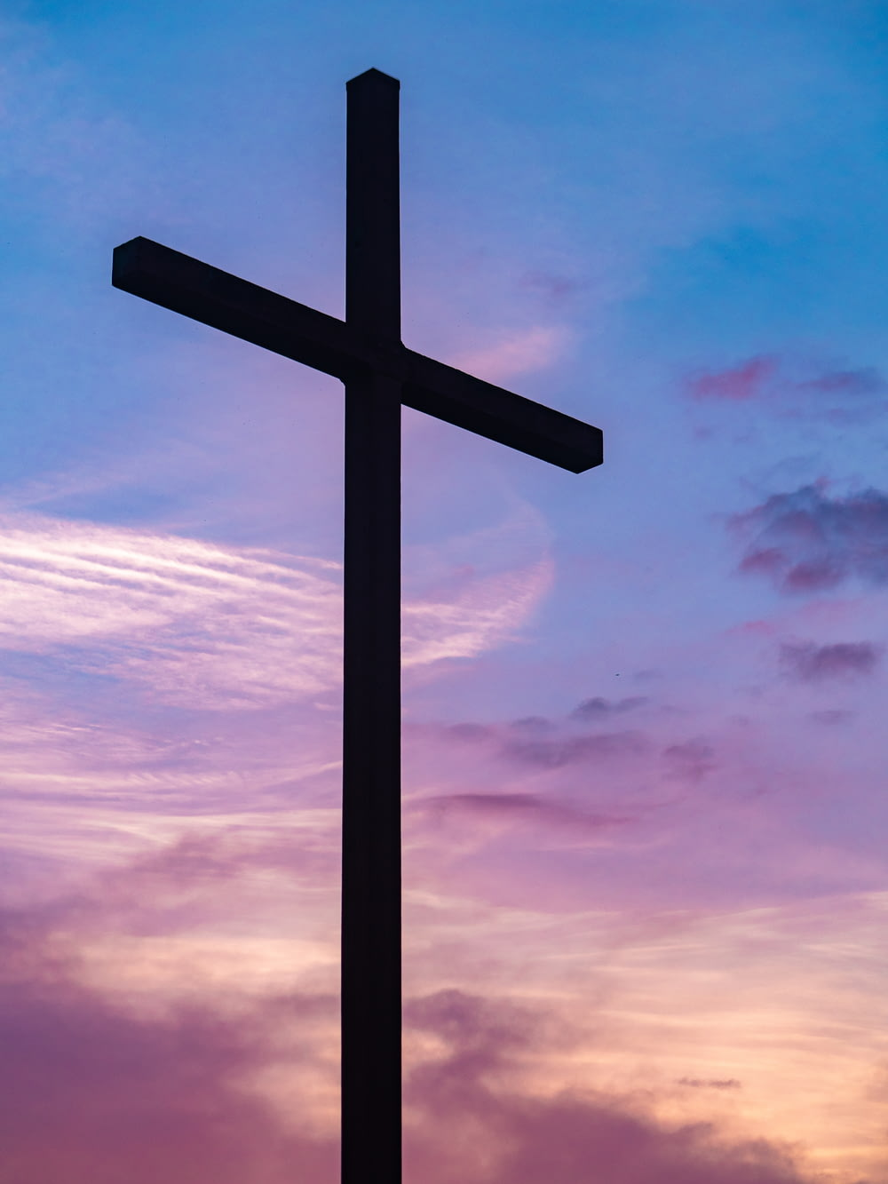 silhouette photo of cross during blue hour