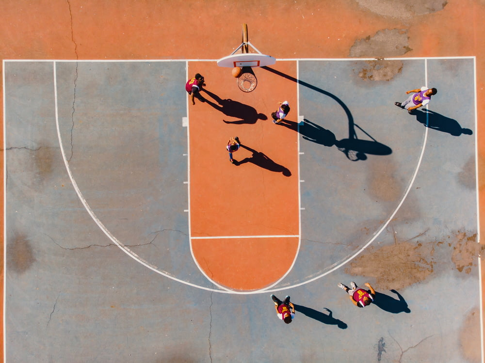 aerial photography of men playing basketball