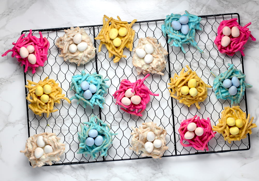 assorted-color eggs on nest wall decor