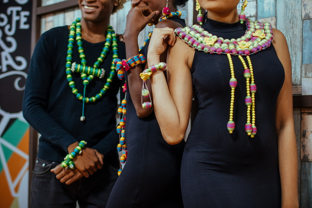 woman wearing black dress and multicolored necklace